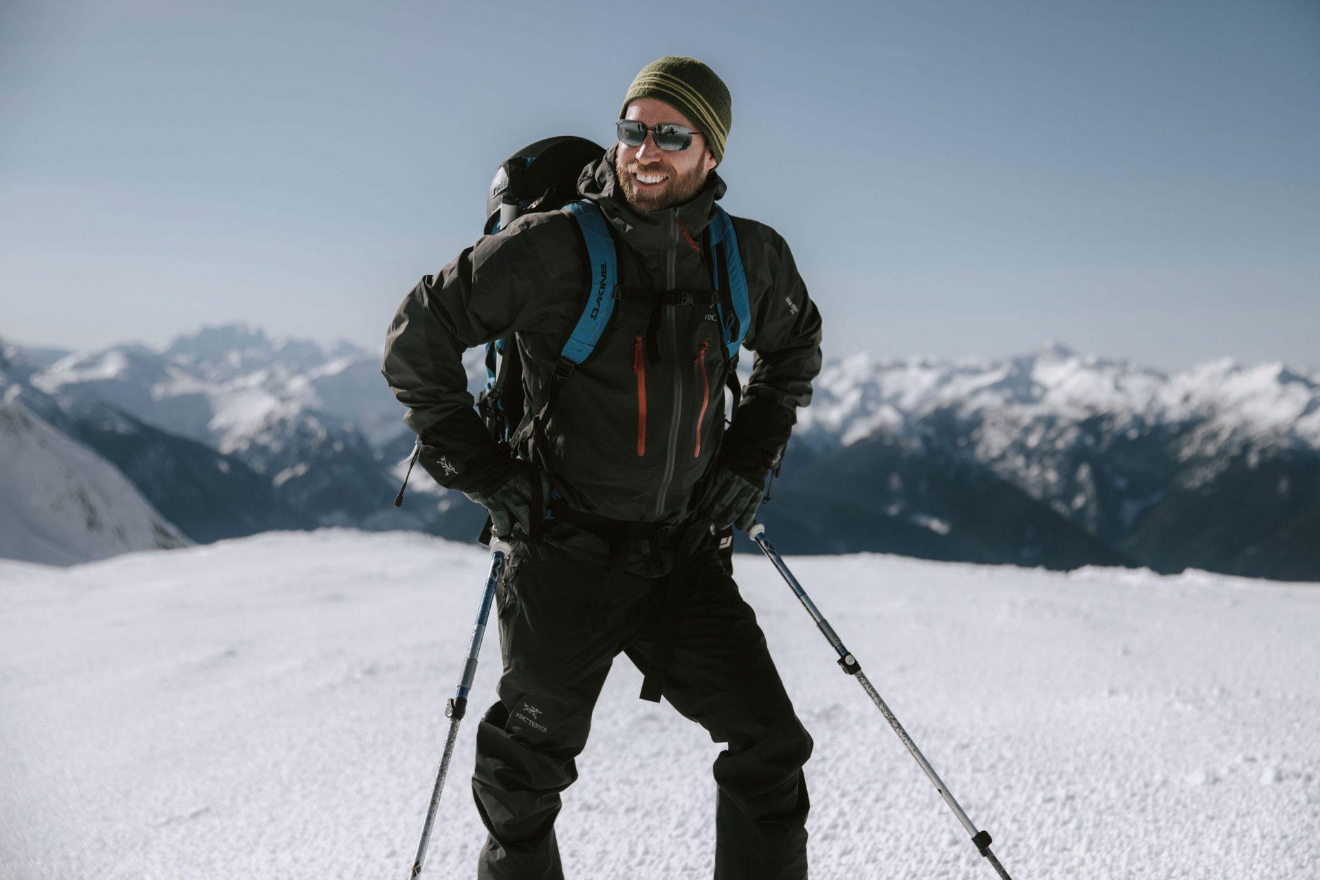 A smiling adventurer in the Lillooet Range