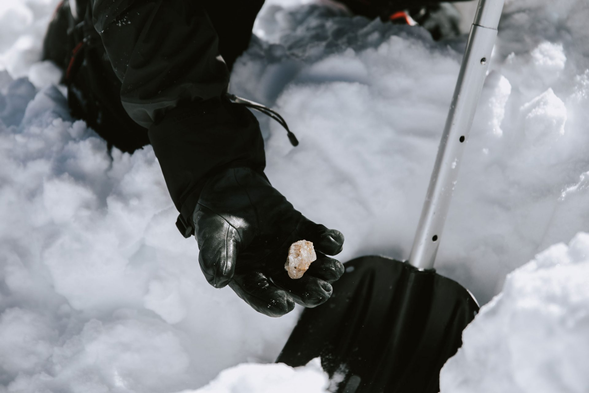 Man holding an ice crystal while on a chartered heli-tour