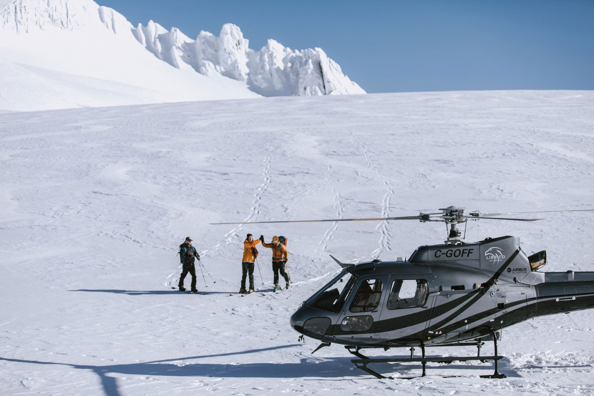 The Librico Helicopters with three snowshoeing adventurers