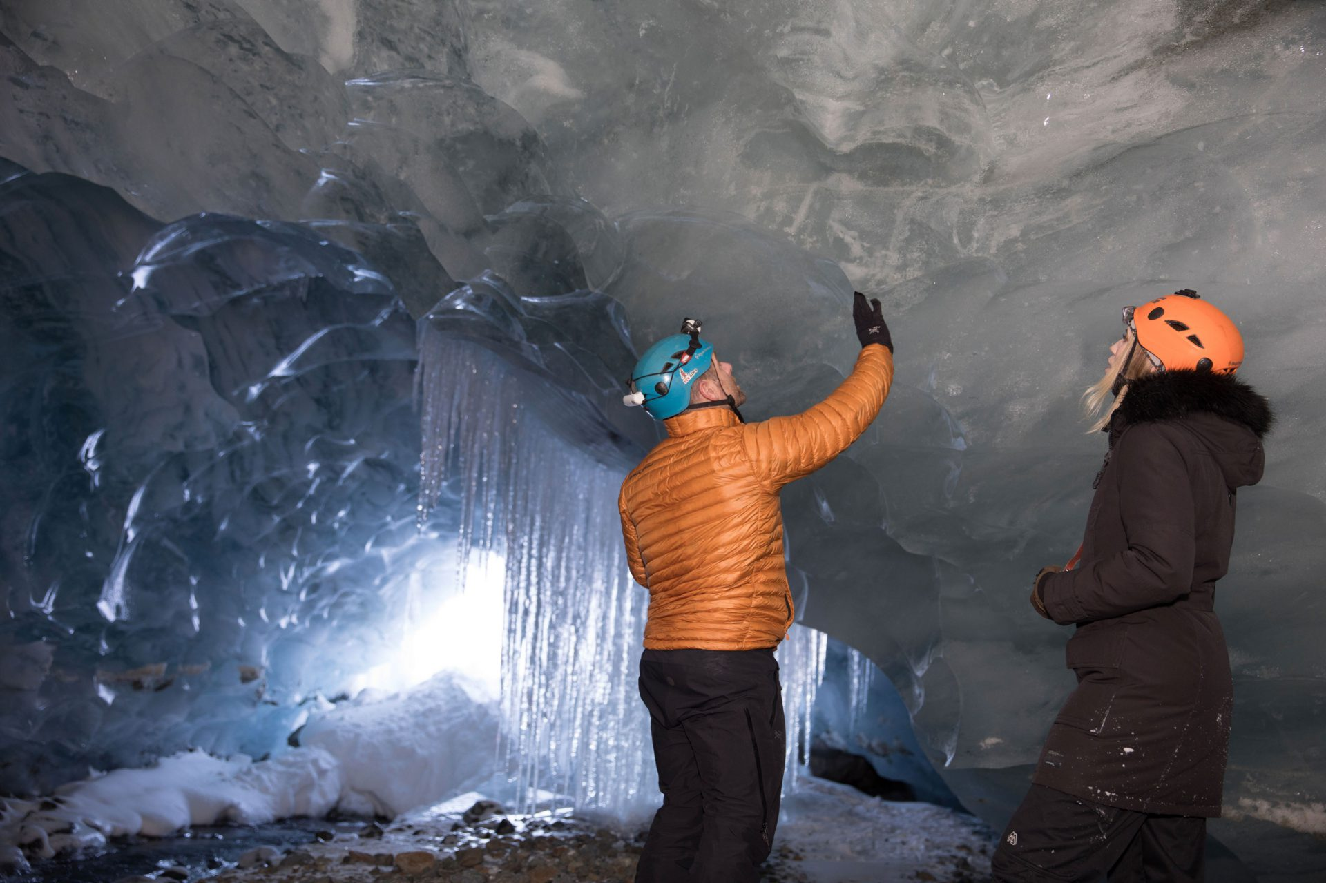 Looking at the ice formations in the ice cave on a Librico Helicopters tour