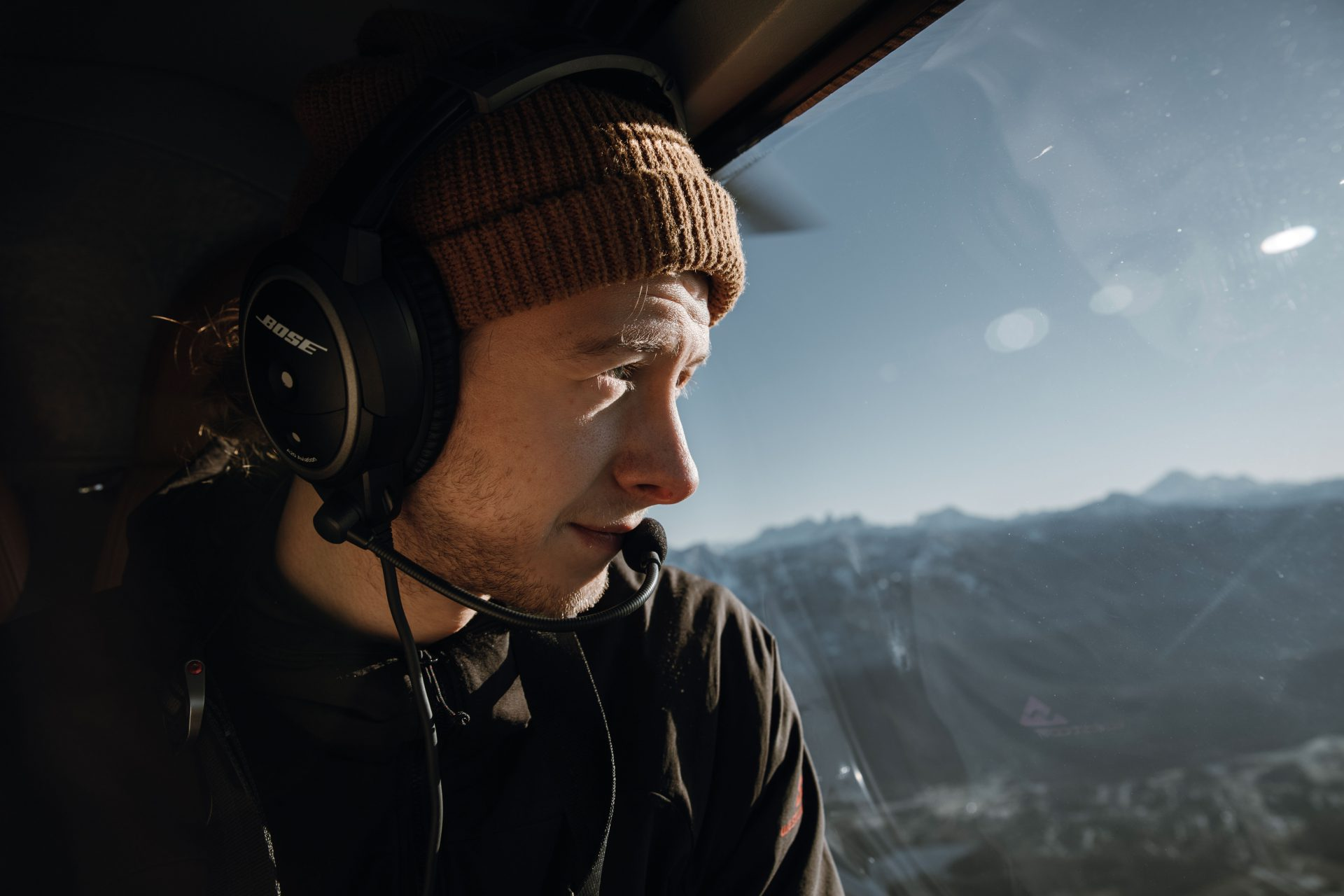 Inmist Media house crew member on a heli tour over the Cascade Mountains in BC, Canada
